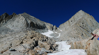 Heading up the snow and talus to the low point. Summit on the left.