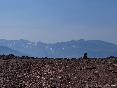 Cairn and peaks to the south