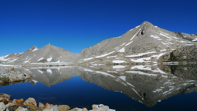 First we have to pick our way around Lake 3535. It's a beautiful, clear, still morning.   Mather Pass is the low point on the ridge. We later found out that Paige and crew crossed the pass about the same time we were on the Split Mtn summit. Hi guys!