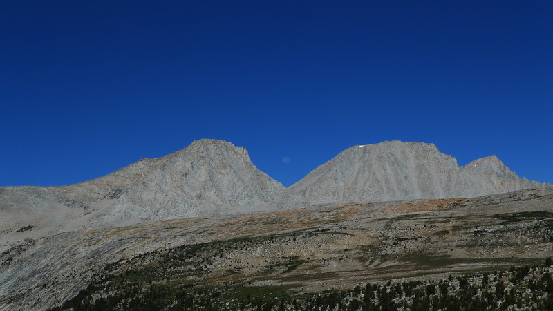 Moon between Merriam and Royce Peaks