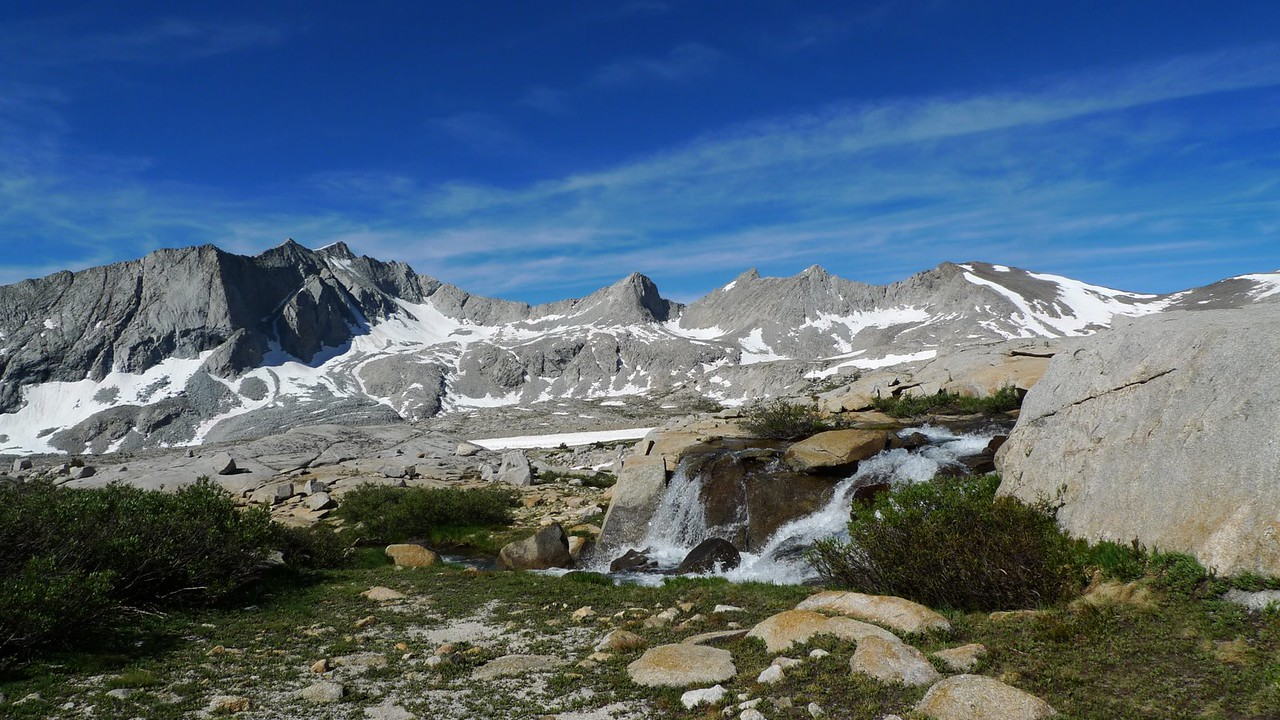 Frozen Lake Pass (distance) and a tumbling cascade in Upper Basin