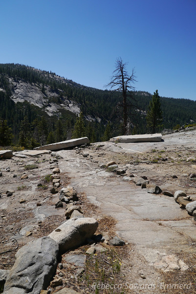 At times the trail crosses open granite and is marked with small rocks and cairns.