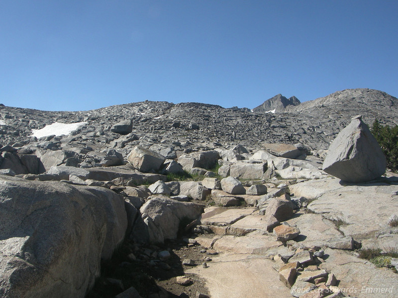 The trail is sometimes easy to lose among these rocks. Mt Davis is visible over the ridge.