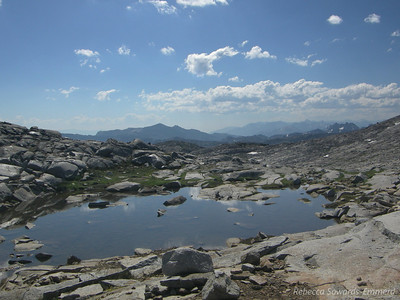 At the pass - this one is relatively flat and exposed, and even has this nice tarn for refilling your drinking water.