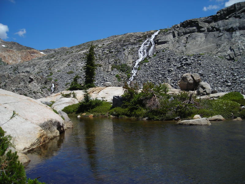 Seasonal Waterfall<br /> <br /> As we approach the peninsula that separates the two Twin Lakes, we are treated to a stunning view of a fresh snowmelt waterfall dumping into the lake. Above the waterfall is Island Lake where we camped two years ago.