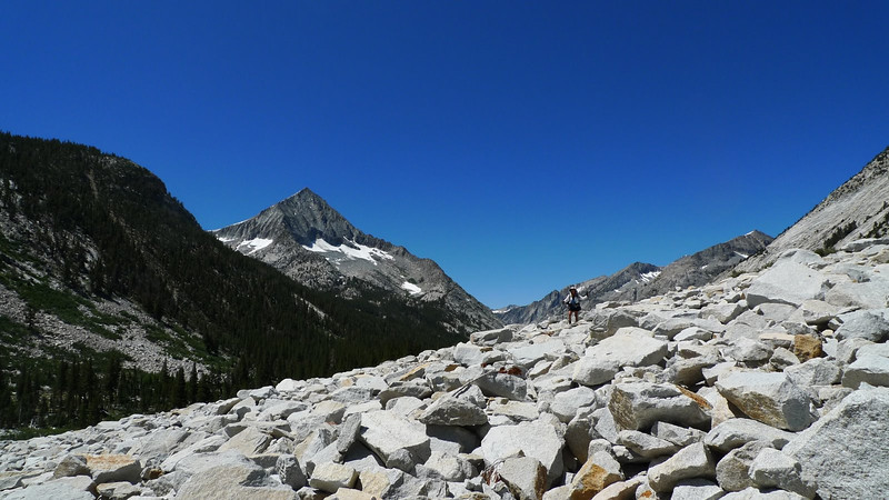 Back down along the South Fork, crossing one of the three rock slides. Arrow Peak towers above.