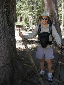 Dave at the Yosemite Park Boundary  Lined with barbed wire (to keep out the riffraff, I suppose)