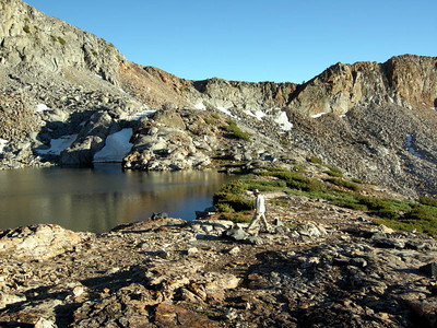 Steve looks for a campsite at Upper Ottoway  This spot was absolutely beautiful, but lacking in campsites (but not in bivy spots) - crystal clear water, surrounded by stunning peaks - a perfect high sierra experience