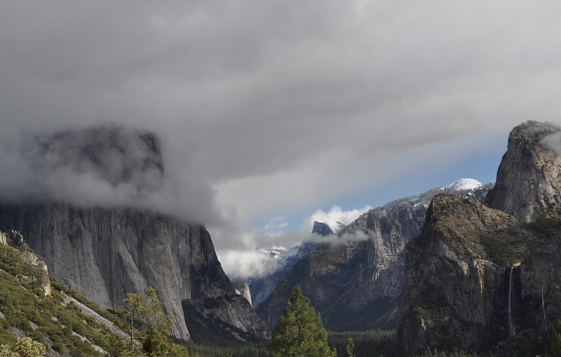 Tunnel View: El Cap in the clouds, Half Dome in the middle, Bridalveil falls on the right.