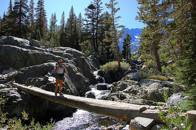 sierra-mountains-hiker-bridge-crossing