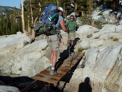 Crossing this rickety bridge to our lakeside campsite.