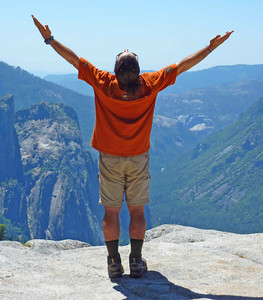 Guide Diego doing Sun Salutations over Yosemite Valley on the Pohono Trail.