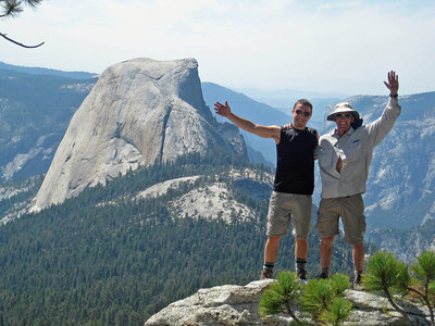 Guides Michael and Tom on Guide Rock in front of Half Dome in Yosemite.