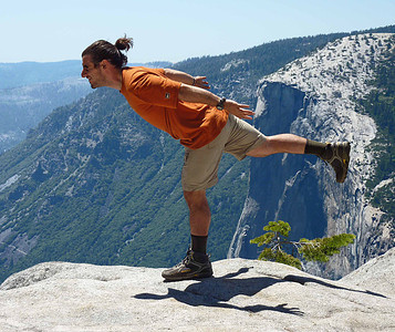 Guide Diego doing sun salutations overlooking Yosemite Valley on the Pohono Trail. Middle school teacher in NJ in the off-season.