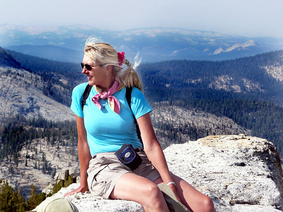 Lead Guide, Karen, on top of Tenaya Peak in Yosemite. Quit her job as a Clinical Laboratory Scientist in May of 2011 to work on guiding year round. Been guiding for 15 years. Considers the Sierra her real home.