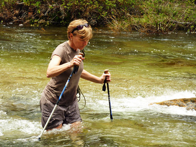 Guide Val carefully crossing Yosemite Creek on the Yosemite Creek Trip during spring run-off 2010. BTW, Val HATES stream crossings. She does gymnastic moves on log crossings but hates wading them. Degree in biology, she works to keep California's food pesticide free.