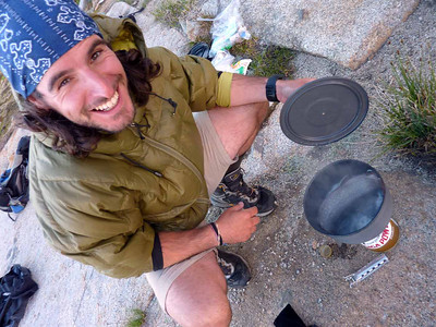 Guide Diego cooking a freshly caught dinner off trail in Kings Canyon. Been known to catch fish on shock cord and a hook when he forgot his reel.