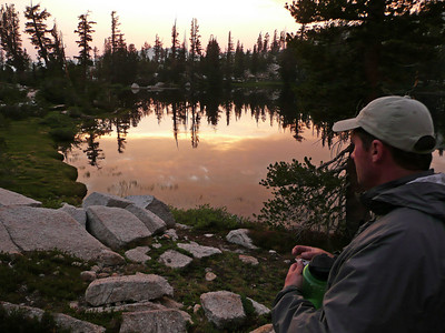 Guide Mike checking out the evening sunset reflection on Cathedral Lake.