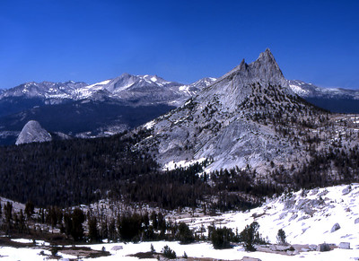 Fairview Dome, Cathedral Peak, and Conness to the north. Lots of snow in late June.