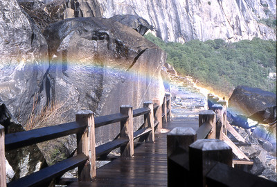 Walk under a rainbow on the Wapama Falls Bridge.