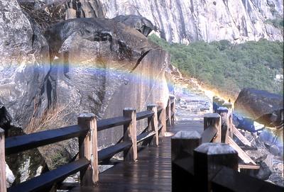Walk under a rainbow on the Wapama Falls Bridge.