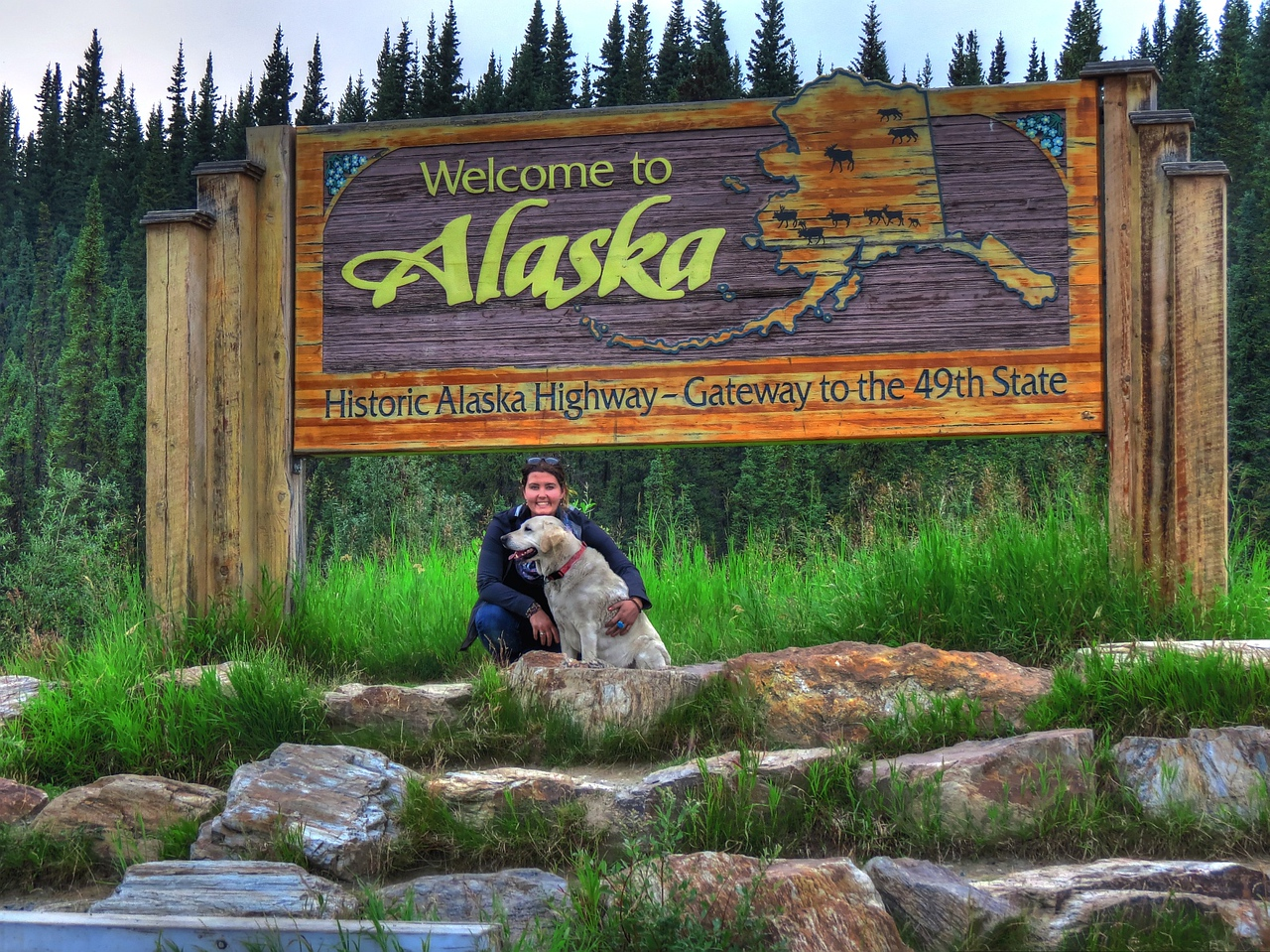 Mallory Paige and Baylor, happy to reach Alaska, even though not riding on/in the motorcycle at this time.