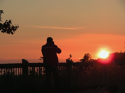 At the overlook above Homer, Alaska, my friend Ricardo getting a shot of the sun setting across Cook Inlet.