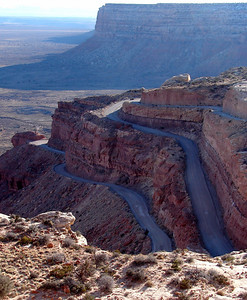 A road called Moki Dugway in the state of Utah.  Approaching from below, you can't even make it out on the face of the cliff until you're right at the bottom, ready to start up.