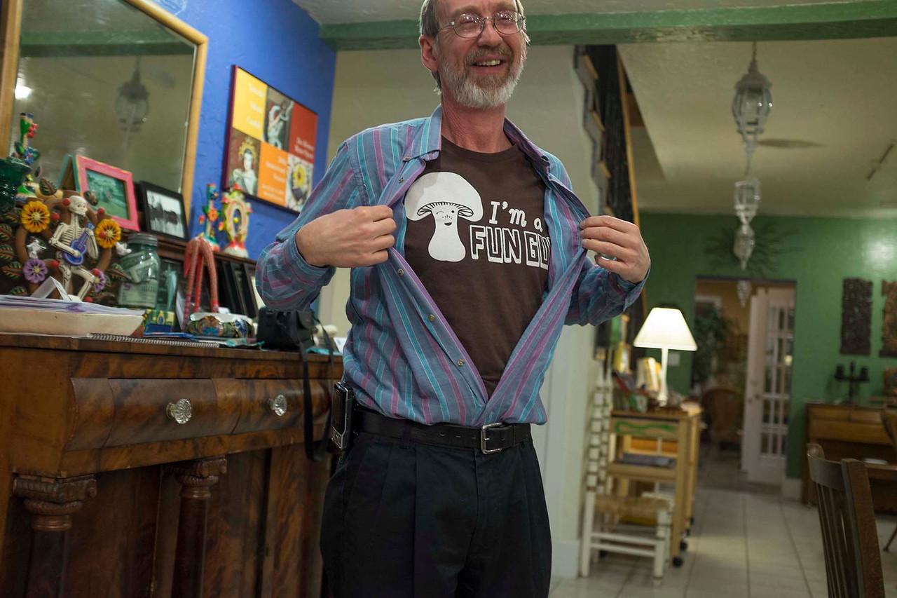 """Prairie States Mushroom Club Winter dinner at Montebello Inn. Glen shows off his """"I'm a FUN GUY"""" tee shirt."""