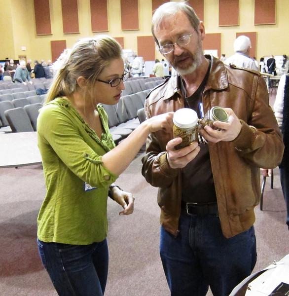 Glen shows Johnson County Heritage Trust Marketing Intern Anika some preserved mushrooms.