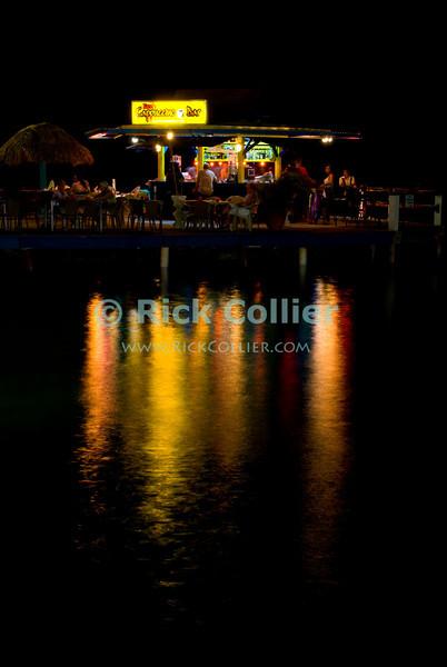 "Kralendijk, Bonaire, Netherland Antilles -- The over-water cappuccino bar on the Kralendijk waterfront does a steady business most nights.   © Rick Collier<br /> <br /> <br /> <br /> <br /> Bonaire; ""Netherlands Antilles""; Caribbean; tropic; tropical; vacation; destination; Kralendijk; night; lights; moon; bar; entertainment; waterfront; street; ""street scene""; pier; dock; harbor; anchorage; seawall; ""sea wall"";"