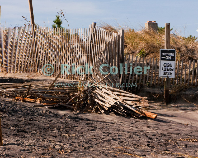 Sand fences, walkways, and signs along Bethany Beach, Delaware, show damage from a nor'easter that just passed in November 2009.