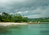 Amanoka Villa, Discovery Bay, Saint Ann Parish, Jamaica.  Dramatic clouds mark the leading edge of a storm front, reflecting off the calm waters of the bay.  © Rick Collier<br /> <br /> <br /> <br /> <br /> <br /> Jamaica Discovery Bay Dry Harbor Bay Amanoka Villa tropical island paradise beach summer fun relaxation storm front clouds reflection white sand beach blue green water