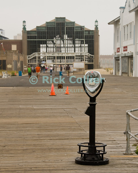 """""""Casino View"""" - The old shell of the Casino sits astride the boardwalk between Ocean Grove and Asbury Park, New Jersey, USA.<br /> <br /> <br /> USA """"New Jersey"""" NJ """"Ocean Grove"""" """"Asbury Park"""" Asbury Ocean Grove beach boardwalk Casino shell ruin derelict viewer binoculars pay machine"""