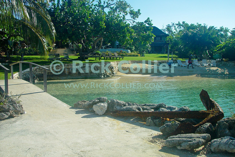 Amanoka Villa, Discovery Bay, Saint Ann Parish, Jamaica.  A lovely secluded beach and everything you need for a beach holiday await at the exclusive Amanoka Villa.  © Rick Collier<br /> <br /> <br /> <br /> <br /> <br /> Jamaica Discovery Bay Dry Harbor Bay Amanoka Villa tropical island paradise beach summer fun relaxation swimming pool shade tree water