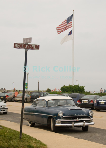 """On the way to Heck"" - An antique Hudson (car) is parked at Heck Avenue, at the intersection with Ocean Avenue near the boardwalk at Ocean Grove, New Jersey, USA.<br /> <br /> <br /> USA ""New Jersey"" NJ ""Ocean Grove"" Ocean Grove flag street sign heck ""Heck Avenue"" ocean ""Ocean Avenue"" Hudson antique car park parked boardwalk beach boardwalk"