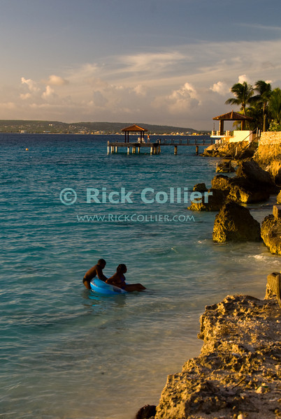 """Bonaire, Netherland Antilles -- Bachelor's Beach is one of many marked swimming and dive sights on Bonaire.  This particular place is also popular with locals looking for an evening swim near sunset most days. © Rick Collier<br /> <br /> <br /> <br /> Bonaire; """"Netherlands Antilles""""; Caribbean; tropic; tropical; vacation; destination; beach; bachelor; bachelor's; """"bachelor's beach""""; swim; swimming; play; """"water play""""; snorkeling; seashore;"""