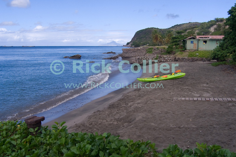 St. Eustatius (Statia) - The beach in front of Dive Statia, with  historical and not-so historical ruins in the background.  Saba is also visible on the horizon in the center of this photo.  © Rick Collier