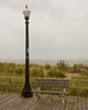 """Ocean View"" - The boardwalk in Ocean Grove, New Jersey, USA, is mostly deserted in wintertime.<br /> <br /> <br /> USA ""New Jersey"" NJ ""Ocean Grove"" Ocean Grove Ocean Avenue beach boardwalk streetlight bench seat railing dune dunes sea Atlantic Ocean"