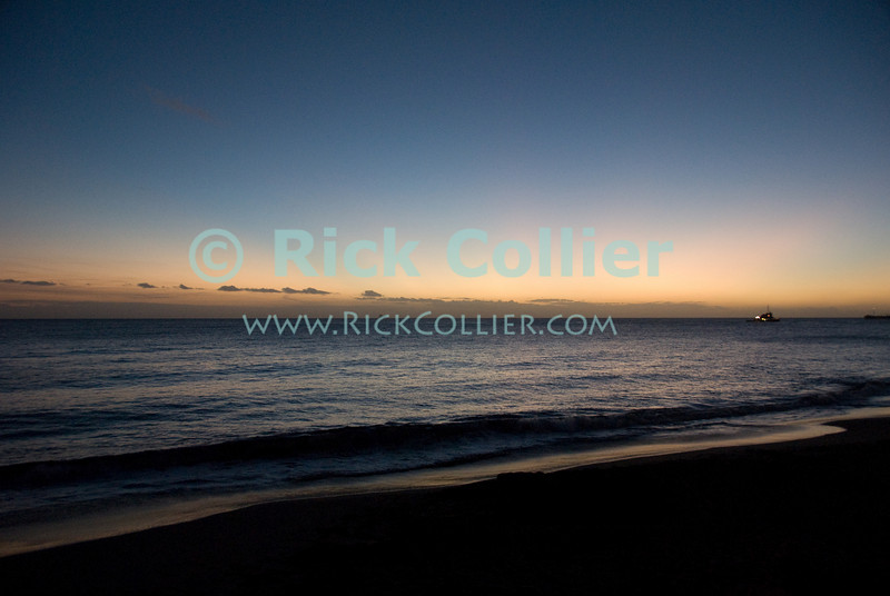 St. Eustatius (Statia) - Scenic view out into the Caribbean sea from the beach at sunset.  A beautiful sunset over the deserted beach in Lowertown.  © Rick Collier