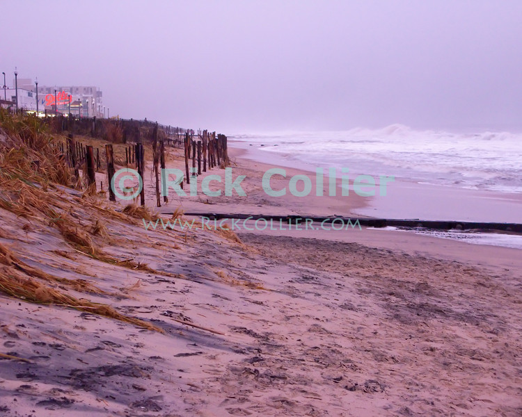 The line of an old sand fence, formerly burried under the dunes, is exposed by the waves of a major nor'easter in November 2009 at Rehoboth Beach, Delaware, USA.