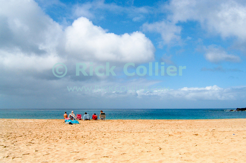 This family of obvious TOURISTS walked onto a large empty beach and chose the only place that would place them directly between us and the water.  Waimea Beach, North Shore, Oahu, Hawaii.  © Rick Collier<br /> <br /> <br /> <br /> <br /> <br /> <br /> Hawaii Hawai'i Oahu Waimea Beach North Shore ocean beach tourist tourists family