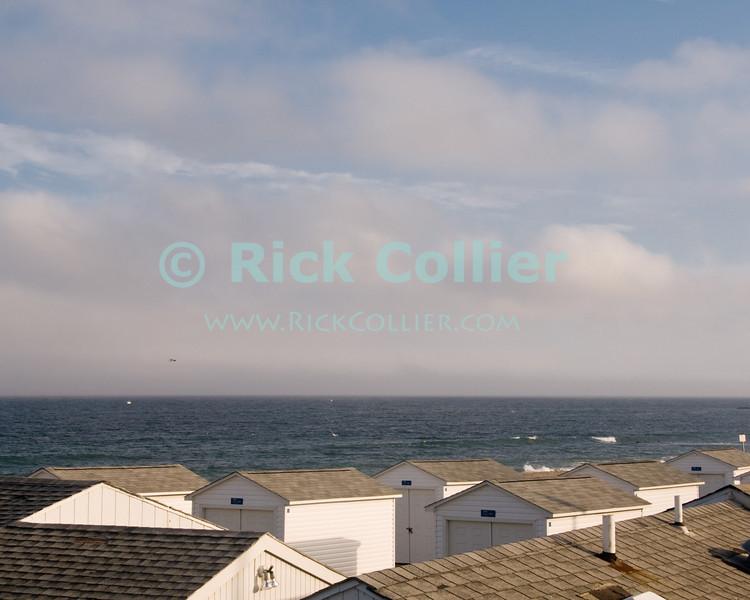 """Cabana roofs"" - Shut up cabanas await the return of summer season.  Allenhurst, New Jersey, USA.<br /> <br /> <br /> USA ""New Jersey"" NJ Allenhurst beach shed cabana cottage building shack building roofs"