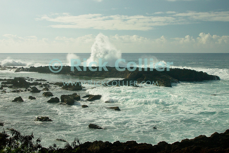 Waves break at the outside of the huge tidal pool at Shark Cove (so called because of the shape of the inlet at this site).  This is a favorite wading, snorkeling, and diving site at North Shore, Oahu, Hawaii.  © Rick Collier<br /> <br /> <br /> <br /> <br /> <br /> <br /> <br /> Hawaii Hawai'i Oahu North Shore beach surf waves ocean sea seashore Shark Cove wading tidal pool