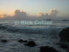 St. Eustatius (Statia) - Sunset illuminates the clouds over the Caribbean as waves break on the rocky beach.  © Rick Collier