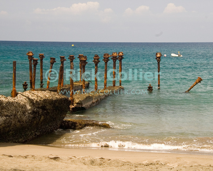 """The beach and remains of an old dock stand just off the beach at Dive Statia.  St. Eustatius (Statia), Netherlands Antilles.<br /> <br /> <br /> <br /> <br /> """"St. Eustatius"""" """"Saint Eustatius"""" Statia Netherlands Antilles """"Lesser Antilles"""" Caribbean beach dock ruins surf ocean waves sea """"Dive Statia"""""""