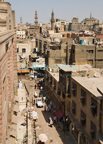 """Cairo, Egypt -- View from the minarets of the Bab Zuwayla gate.  One of the three first gates installed around the historic walled city of Cairo, standing at the southern boundary of old Fatimid Cairo.  The two minarets atop this tower actually belong to the nearby Mosque of al-Mu'ayyad, which sits just inside this gate (on the left).  For a small fee, it is possible to climb the minarets for a spectacular view of old and new Cairo. © Rick Collier / RickCollier.com.<br /> <br /> <br /> <br /> <br /> <br /> travel; vacation; tour; tourism; tourist; destination; Egypt; Cairo; city; view; gate; walls; bab; """"Bab Zuwayla""""; Zuwayla; minaret; Fatimid; Fatmid; """"city gate""""; """"Islamic Cairo"""";"""