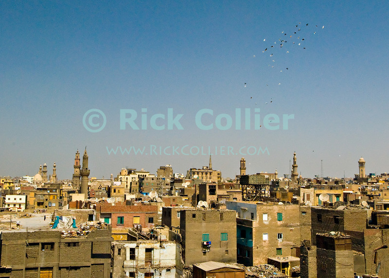 """Cairo, Egypt -- View from the minarets of the Bab Zuwayla gate.  One of the three first gates installed around the historic walled city of Cairo, standing at the southern boundary of old Fatimid Cairo.  The two minarets atop this tower actually belong to the nearby Mosque of al-Mu'ayyad, which sits just inside this gate (on the left).  For a small fee, it is possible to climb the minarets for a spectacular view of old and new Cairo, featuring many minarets above the old city. © Rick Collier / RickCollier.com.<br /> <br /> <br /> <br /> <br /> <br /> travel; vacation; tour; tourism; tourist; destination; Egypt; Cairo; city; view; gate; walls; bab; """"Bab Zuwayla""""; Zuwayla; minaret; Fatimid; Fatmid; """"city gate""""; """"Islamic Cairo"""";"""