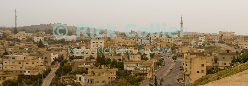Mist closes in at the end of the day at the town of Umm Qais, viewed from the acropolis ruins of the biblical town of Gadara.  © Rick Collier<br /> <br /> <br /> <br /> Jordan 'Umm Qais' Ottoman Roman Gadara Gadarenes Bible Biblical Arab town minaret skyline