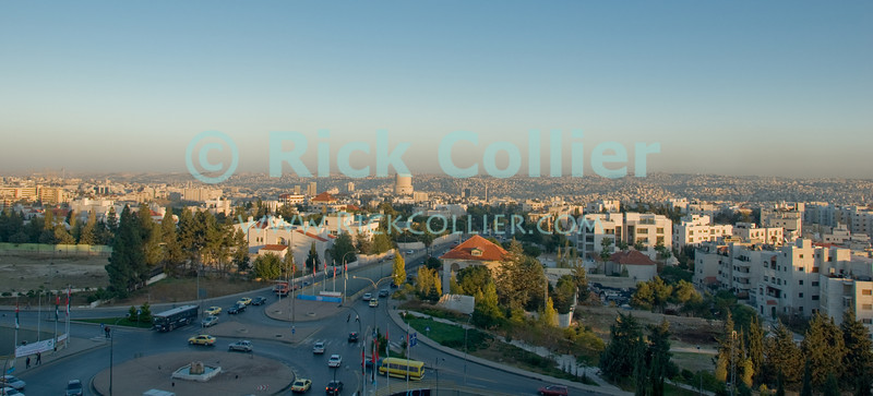 Amman, Jordan - The city skyline revealed in late afternoon.  © Rick Collier<br /> <br /> <br /> Amman Jordan 'city skyline' panorama buildings evening 'traffic circle'